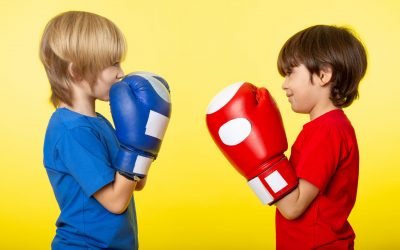 front-view-boys-faceoff-different-colored-boxing-gloves-t-shirts-yellow-wall
